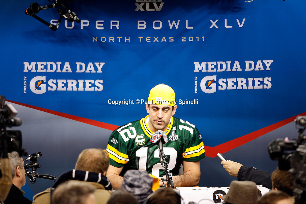 Green Bay Packers quarterback Aaron Rodgers (12) speaks to the press at Super Bowl XLV media day prior to NFL Super Bowl XLV against the Pittsburgh Steelers. Media day was held on Tuesday, February 1, 2011 in Arlington, Texas. ©Paul Anthony Spinelli