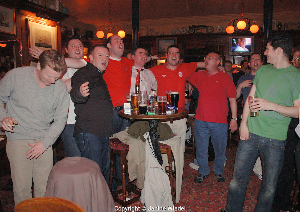 Group of Liverpool supporters watching football match in local pub They won the UEFA Champions League against AC Milan June 2005.