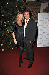 Actress TINA HOBLEY and her husband OLIVER WHEELER at a Christmas Carol service in aid of Breast Cancer Haven held at St.Paul's Knighsbridge, Wilton Place, London on 8th December 2009.