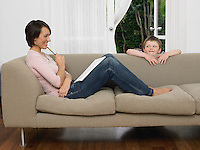 Mother and young son by couch
