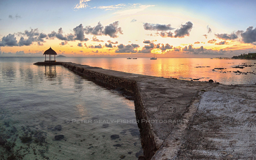 A romantic jetty after sunset at the beautiful Paul et Vergini hotel on the Eastern side of Mauritius