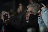 KELOWNA, CANADA - JANUARY 5: An elderly fan uses a smart phone during the national anthem at the Kelowna Rockets against the Seattle Thunderbirds on January 5, 2017 at Prospera Place in Kelowna, British Columbia, Canada.  (Photo by Marissa Baecker/Shoot the Breeze)  *** Local Caption ***