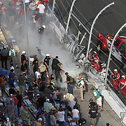 Debris is seen on fire in the spectator grandstand area after a massive wreck on the front stretch during a NASCAR Drive for COPD 300 race at Daytona International Speedway on Saturday, February 23, 2013 in Daytona Beach, Florida.  (Photo/Alex Menendez)