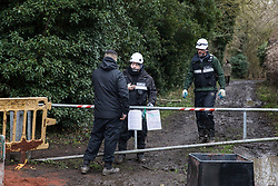Harefield, UK. 14 January, 2020. Enforcement agents working on behalf of HS2 liaise at the entrance to a public right of way leading to a protection camp from which Stop HS2 activists are currently being evicted before deciding to deny access to press. 108 ancient woodlands are set to be destroyed by the high-speed rail link and further destruction of trees for HS2 in the Harvil Road area is believed to be imminent.