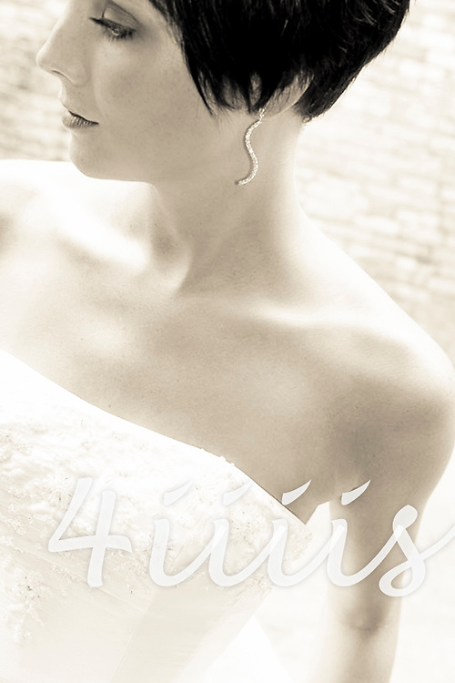 Portrait of a Bride in Brandon Manitoba.  Toned Black and White photo of bride with a brick wall in background.