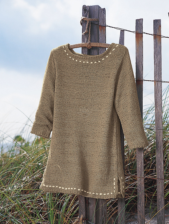We photographed this tan knit top suspended from a rustic hanger on the beach in Florida for Mark, Fore & Strike.