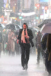 """Keanu Reeves appears very exhausted and in pain while filming intense running scenes in the pouring rain for more than 10 hours straight with his pit bull costar by his side for the third installment of """"John Wick"""" in Manhattan's Times Square. Keanu was seen yawning several times and looked very tired as filming started 8pm Monday night and ended at 6am on Tuesday morning. At one point the pit bull ran away from the scene and started fighting with a horse which caused chaos on the set for a few minutes. 19 Jun 2018 Pictured: Keanu Reeves. Photo credit: LRNYC / MEGA TheMegaAgency.com +1 888 505 6342"""