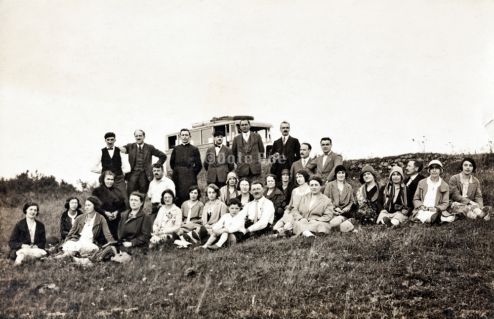 priest with congregation during a pilgrimage group trip early 1900s France