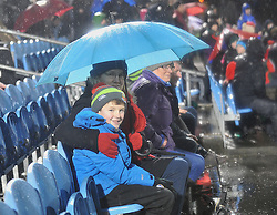 Undercover from the elements Mayo supporters Oisin King with his mum Caroline at McHale Park on saturday as Mayo took on the Dubs. Pic Conor McKeown