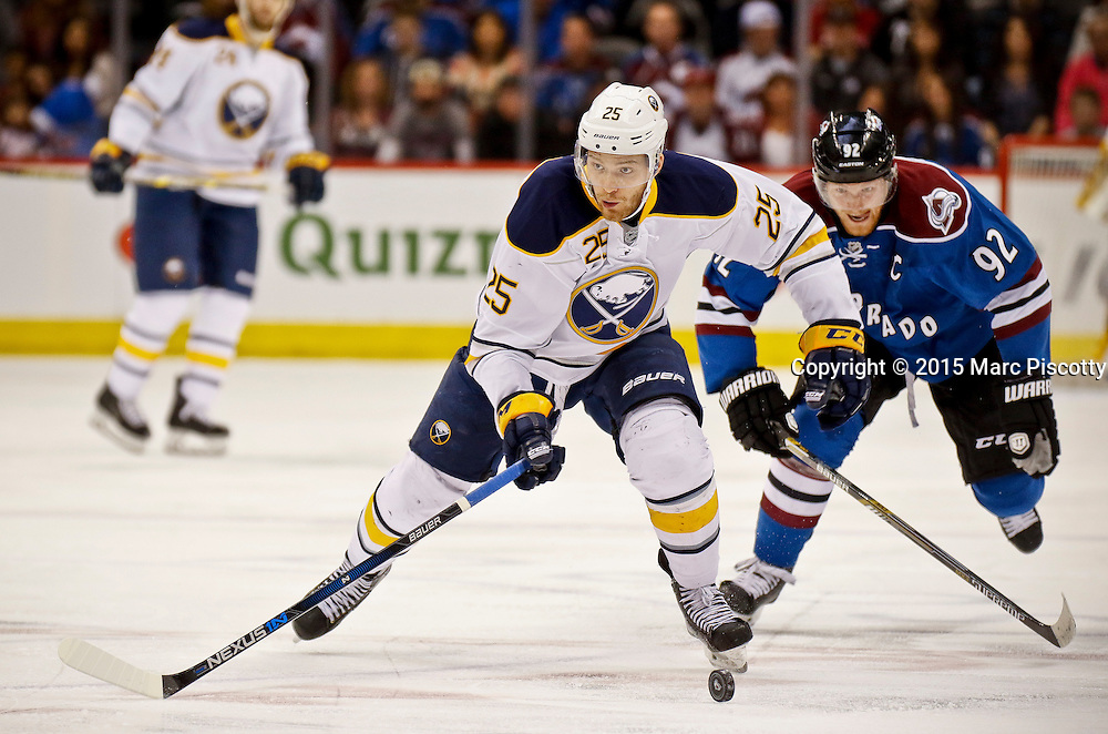 SHOT 3/28/15 7:12:23 PM - The Buffalo Sabres' Mikhail Grigorenko #25 pushes the puck up ice as the Colorado Avalanche's Gabriel Landeskog #92 gives chase during their regular season NHL game at the Pepsi Center in Denver, Co. The Avalanche won the game 5-3. (Photo by Marc Piscotty / © 2015)