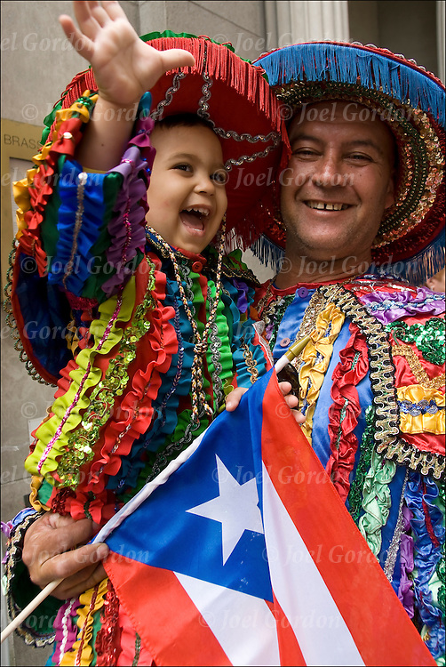 Puerto Rican American grandfather from Moca, the north-western region of the island, and his grandson wearing their traditional folk regalia for the Puerto Rican Day Parade Day Parade.