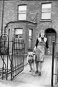 """Bloomsday. Plaque unveiled at James Joyce's birthplace, 41 Brighton Square. 16 Year old Camillla Welimata, grand-niece of Joyce, with her Irish wolfhound """"Finn""""..16.06.1964"""