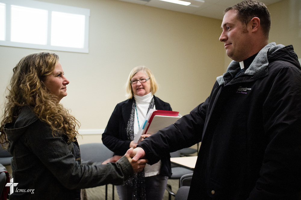 The Rev. Michael W. Meyer, manager of LCMS Disaster Response, shakes hands with Amy Weinberg following a meeting at the Boulder County Sheriff's Office in Boulder, Colo., on Wednesday, Jan. 8, 2014. LCMS Communications/Erik M. Lunsford