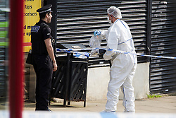 © Licensed to London News Pictures. 16/06/2016. Leeds, UK. Police forensic officer at the scene where Police are at the scene in Birstall, south of Leeds, where Jo Cox, Member of Parliament for Batley and Spen, has been shot and stabbed during a constituency surgery. Photo credit: Andrew McCaren/LNP
