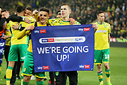 Norwich City midfielder Todd Cantwell (36)  and Norwich City defender Max Aarons (37)  celebrate after the EFL Sky Bet Championship match between Norwich City and Blackburn Rovers at Carrow Road, Norwich, England on 27 April 2019.