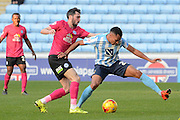 Coventry City midfielder Jacob Murphy and Peterborough United defender Michael Smith battle for the ball during the Sky Bet League 1 match between Coventry City and Peterborough United at the Ricoh Arena, Coventry, England on 31 October 2015. Photo by Alan Franklin.