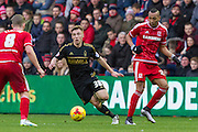 Nottingham Forest midfielder Ben Osborn (38)keeps the ball under pressure during the Sky Bet Championship match between Middlesbrough and Nottingham Forest at the Riverside Stadium, Middlesbrough, England on 23 January 2016. Photo by George Ledger.