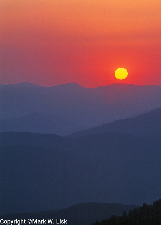 Smoke fills the sky in the Boise National Forest creating an erie sunset near Idaho City.