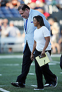 Pro Football Hall of Fame President & Executive Director David Baker walks with ESPN sideline reporter Lisa Salters while discussing the field conditions before the Green Bay Packers 2016 NFL Pro Football Hall of Fame preseason football game against the Indianapolis Colts on Sunday, Aug. 7, 2016 in Canton, Ohio. The game was canceled for player safety reasons due to the condition of the paint on the turf field. (©Paul Anthony Spinelli)