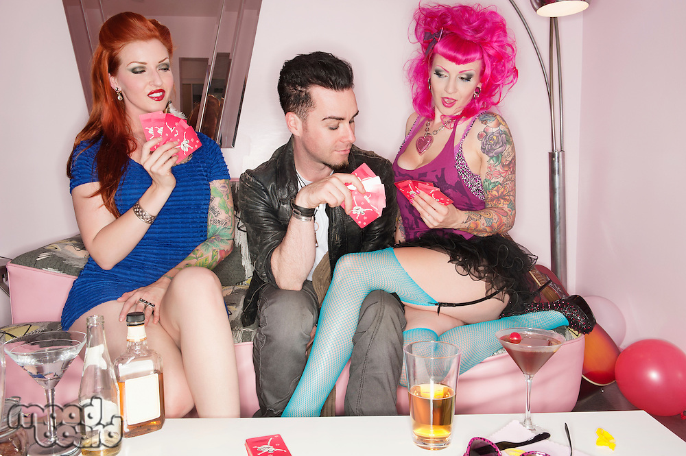 Woman seducing man while playing cards