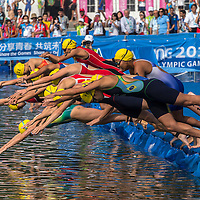 Athletes compete in Triathlon 4x Mixed Relay at Xuanwu Lake in Nanjing Youth  Olympic Games  2014 in Nanjing, China, 21 August 2014. The Nanjing Youth Olympic Games 2014 runs from from 16 to 28 August  2014.