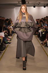 © Licensed to London News Pictures. 30/05/2013. London, England. Collection by Seung-Yeon Jee. Students from the Royal College of Art's MA Fashion prgramme presented their final collections to press and trade. The catwalk show featured 33 collections by students specialising in Menswear, Womenswear, Knitwear and Millinery. Photo credit: Bettina Strenske/LNP