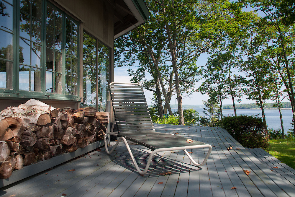 Wood Pile and Chaise Lounge on Deck, Great Island, Castine, Maine, US