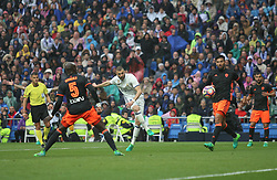 April 29, 2017 - Madrid, Spain - MADRID, SPAIN. APRIL 29th, 2017 - Benzema shoots on goal. La Liga Santander matchday 35 game. Real Madrid defeated 2-1 Valencia with goals scored by Cristiano Ronaldo (26th minute) and Marcelo (86th minute). Parejo (82nd minute) scored for Valencia. Santiago Bernabeu Stadium. Photo by Antonio Pozo | PHOTO MEDIA EXPRESS (Credit Image: © Antonio Pozo/VW Pics via ZUMA Wire/ZUMAPRESS.com)