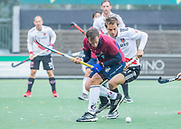 AMSTELVEEN - Enzo Torossi (HCKZ) met Boris Burkhardt (Adam) tijdens de hoofdklasse competitiewedstrijd mannen, Amsterdam-HCKC (1-0).  COPYRIGHT KOEN SUYK
