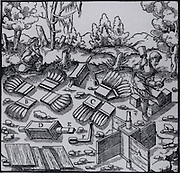 Mine ventillation:  Carpenters assembling a device to be fitted at top of mine shaft so that it would revolve and  extract the stale air from the mine.   From 'De re metallica', by Agricola, pseudonym of Georg Bauer (Basle, 1556).