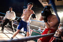 © Licensed to London News Pictures. 24/03/2013. London, UK. Chris Levy (R) and Matt Read compete in a bout of Chessboxing Grand Prix in Scala, London, Saturday evening 23 March 2013. The hybrid sport combines chess with boxing in alternating rounds. The winner is decided by a knock out or checkmate, whichever comes first. A full match consists of eleven rounds: six rounds of chess, each four minutes long, and five rounds of boxing, each three minutes long (four minutes under amateur rules).[4] The match begins with a chess round which is followed by a boxing round. Rounds of chess and boxing alternate until the end of the match.[1][5] There is a one-minute break between each round, during which competitors cool out and change gear.. Photo credit : Peter Kollanyi/LNP