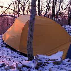Chattahoochee N.F., GA. Appalachian Trail.  A tent at sunrise on Springer Mountain after a spring snow.