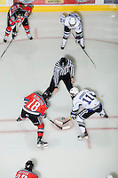 KELOWNA, CANADA, DECEMBER 2: Shane McColgan #18 of the Kelowna Rockets faces off against Steven Hodges #11 of the Victoria Royals as the Victoria Royals visit the Kelowna Rockets  on December 2, 2011 at Prospera Place in Kelowna, British Columbia, Canada (Photo by Marissa Baecker/Shoot the Breeze) *** Local Caption ***