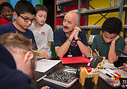 Students learn about the art business from Fletcher Stafford during a session of Career Week at Poe Elementary School, December 5, 2013.