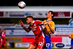 Andy Dales of Scunthorpe United and Lewis Gibbens of Mansfield Town jump to head the ball - Mandatory by-line: Ryan Crockett/JMP - 13/11/2018 - FOOTBALL - One Call Stadium - Mansfield, England - Mansfield Town v Scunthorpe United - Checkatrade Trophy