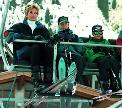 The Princess of Wales and her two sons, Princess William (centre) and Prince Harry, ride in ski lift on the last full day of their Easter skiing holiday in Lech, Austria.