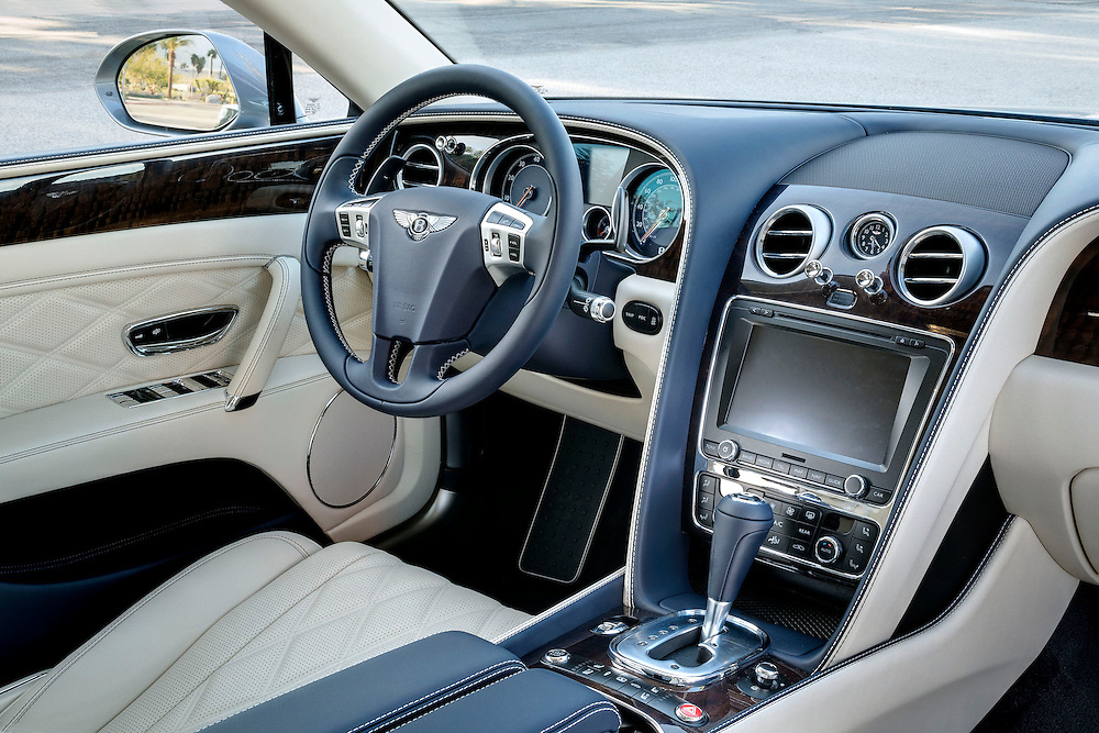 Photo of interior of 2104 silver 2104 Bentley Flying Spur W12. Interior colors Blue and Cream shot in Palm Springs, CA.