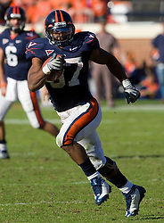 Virginia running back Cedric Peerman (37) in action against Miami.  The Miami Hurricanes defeated the Virginia Cavaliers 24-17 in overtime in a NCAA Division 1 Football game at Scott Stadium on the Grounds of the University of Virginia in Charlottesville, VA on November 1, 2008.