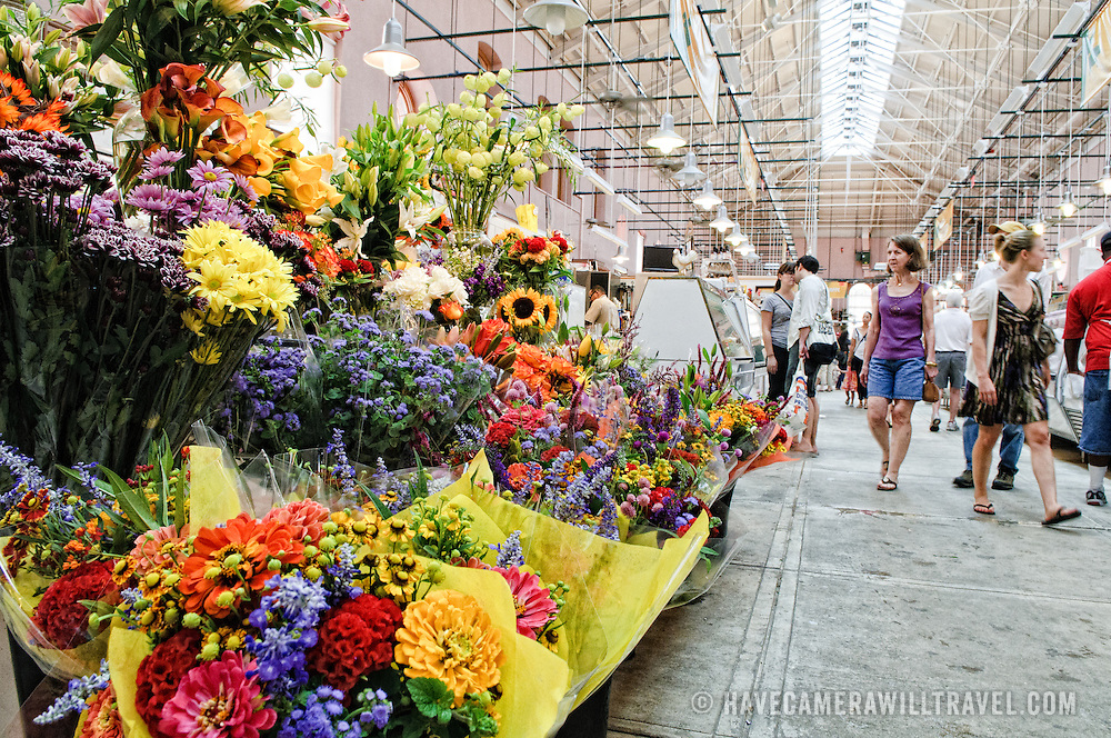 Flowers for sale at the newly restored Eastern Market in Washington DC on Capitol Hill. Badly damaged by an early-morning fire on April 30, 2007, the market building reopened on June 26, 2009.