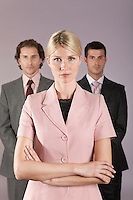 Businesswoman standing in front of businessmen portrait
