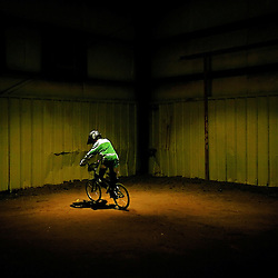 KYLE GREEN | The Roanoke Times<br /> December 27, 2008 - In a dimly lit downstairs staging area, a lone rider practices his riding skills just before competing in the National Bicycle League BMX Christmas Classic and Presidents Cup held at the Virginia Horse Center in Lexington, Virginia. More than 2,000 BMXer&rsquo;s from across the country are expected to attend the event, which runs December 27-29 2008.