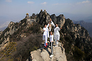 LUOYANG, CHINA - MARCH 08:<br /> <br /> Yoga Performed at 2,000 meters on Laojun Mountain<br /> <br /> Chinese yoga fans perform on a 2,000-meter high precipice on Laojun Mountain, main peak of Funiu Mountain, during Women\'s Day on March 8, 2017 in Luoyang, Henan Province of China. Chinese yoga fans stand at the brink of the precipice to finish difficult yoga poses in celebration of Women\'s Day.<br /> ©Exclusivepix Media