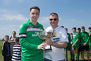 League Secretary Steve McSwiggan presents the Dundee Saturday Morning Football League Premier Division trophy to Hilltown Hotspurs captain Scott Thomson at University Grounds, Riverside, Dundee<br /> <br /> <br />  - &copy; David Young - www.davidyoungphoto.co.uk - email: davidyoungphoto@gmail.com