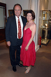 Actor CHRISTOPHER CAZENOVE and ISABEL DAVIS at the Sotheby's Summer Party 2007 at their showrooms in New Bond Street, London on 4th June 2007.<br />