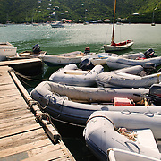 Inflatable dinghies moored to the pier in Cruz Bay, St John.