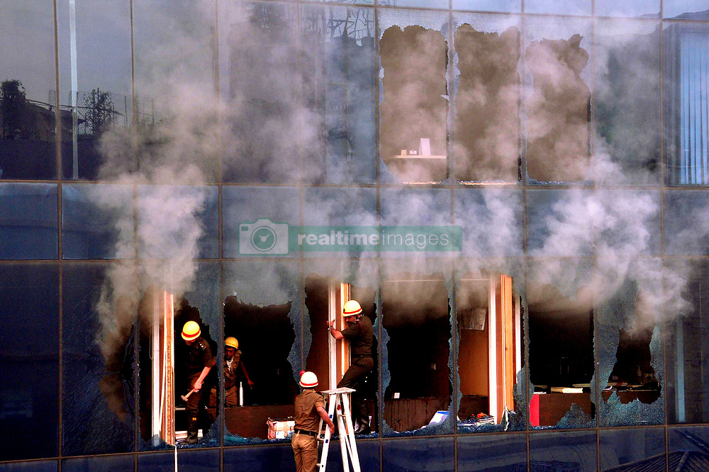 July 20, 2017 - Kolkata, West Bengal, India - A multi-storied building in Central Kolkata, which houses a number of offices, caught fire this afternoon. Some of the glass panes had to be broken for the rescue operations had to be broken for the rescue operations and to release the smoke. There has been no casualty, said fire services minister Sovan Chatterjee, who is also the city mayor. Eight people were taken to a local hospital, six of them were released after First Aid. Two, who fell sick from inhalation of smoke, have been admitted...The fire broke out at the third-floor of the building -- called Aspirations -- in the offices of the Gas Authority of India Limited around 1 pm, sources said.Ten fire tenders were pressed into service to control the blaze - an operation that took more than an hour. The fire tenders had trouble making their way through the narrow lane on July 20,2017 in Kolkata,India. (Credit Image: © Debajyoti Chakraborty/NurPhoto via ZUMA Press)