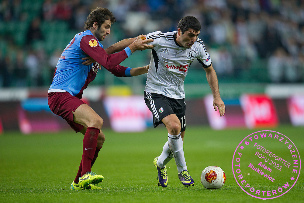 (R) Legia's Vladimer Dvalishvili fights for the ball during the UEFA Europa League Group J football match between Legia Warsaw and Trabzonspor AS at Pepsi Arena Stadium in Warsaw on November 07, 2013.<br /> <br /> Poland, Warsaw, November 07, 2013<br /> <br /> Picture also available in RAW (NEF) or TIFF format on special request.<br /> <br /> For editorial use only. Any commercial or promotional use requires permission.<br /> <br /> Mandatory credit:<br /> Photo by &copy; Adam Nurkiewicz / Mediasport