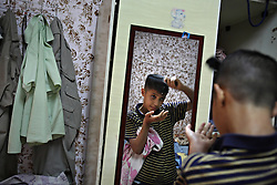 Iraqi refugee Ahmad Thamer, 13, is seen getting ready for the first day of school in Amman, Jordan, Aug. 19, 2007. His family fled the violence in Baquba, Iraq two years ago and are waiting for asylum from the U.N. Refugee Agency so they can finally make a permanent home.