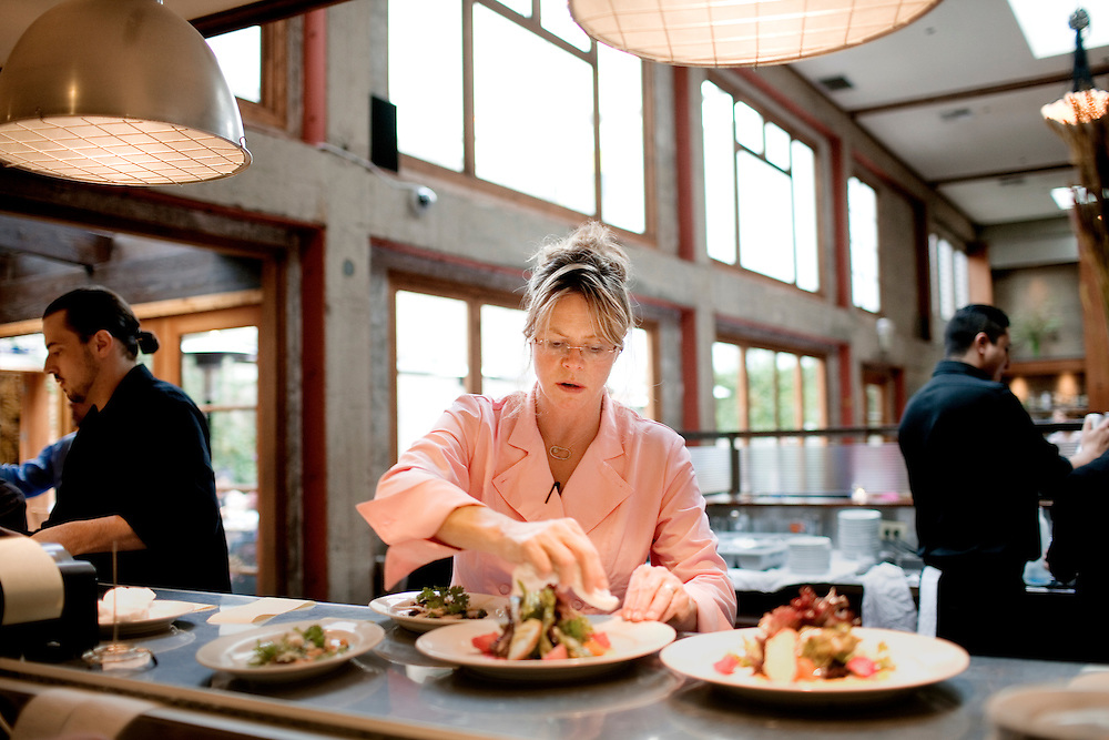 Foreign Cinema chef and owner Gayle Pirie preps plates in the kitchen before they are taken to the tables during dinner, in San Francisco, CA., on Friday, June 12, 2009..