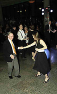 Burt Saidel, from Dayton (left) takes a spin on the dance floor with singer Michelle Zimmerman, from Mason during her performance at the 21st birthday party of the Human Race Theatre Company in Sinclair's Ponitz Center, Saturday night, April 28th.